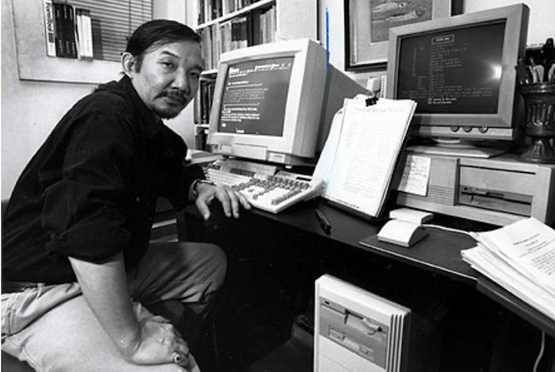 Photograph of Kiyoshi Kuromiya at his computer