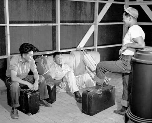 Figure 1: Three young evacuees drop their baggage and relax to argue about whose bunk goes in which corner on arriving at their new quarters. Courtesy of the Colorado Historical Society, F32,640