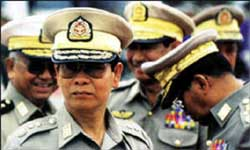 Figure 2: Police and troops on guard outside Suu Kyi's house.