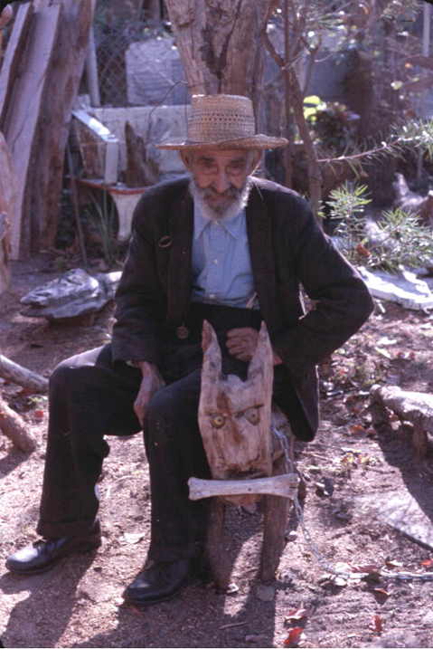 Figure 2: Sculptor Jesse J. Aaron with one of his wood sculptures, Gainesville, Florida, 1976