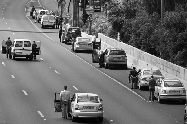 Israelis stand still during a two-minute siren for Soldiers Memorial Day